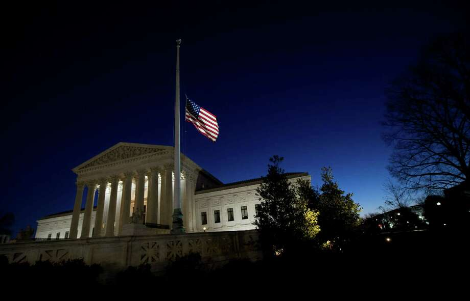 A U.S. flag flies at half-staff in front of the U.S. Supreme Court in Washingtonon Feb. 14, 2016, after the death of Supreme Court Justice Antonin Scalia.  (AP Photo/Manuel Balce Ceneta, File) Photo: Manuel Balce Ceneta, STF / Copyright 2016 The Associated Press. All rights reserved. This material may not be published, broadcast, rewritten or redistribu
