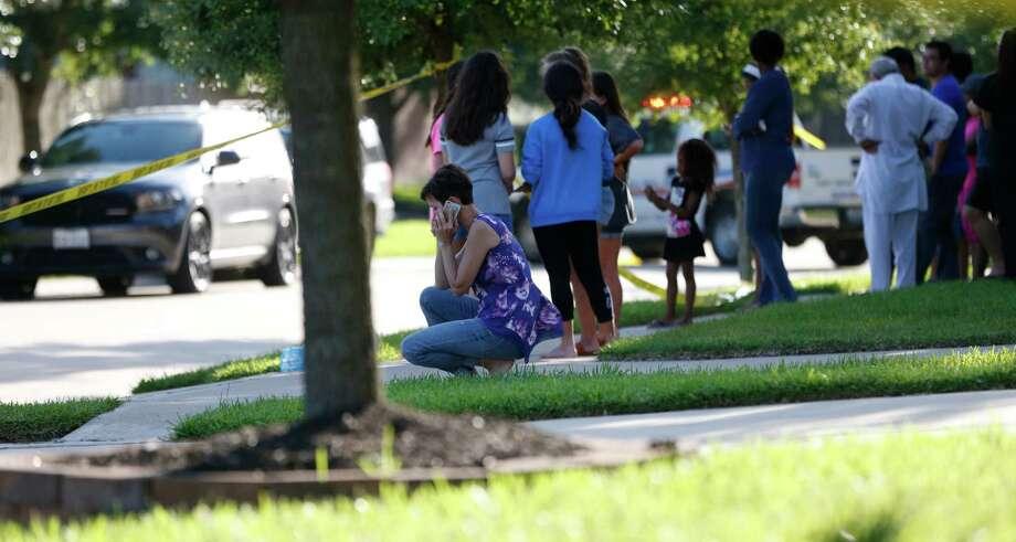 The Sheats shooting shook the suburban neighborhood June 24 as residents gathered to watch officers investigate the scene. ( Karen Warren / Houston Chronicle ) Photo: Karen Warren, Staff / © 2016 Houston Chronicle