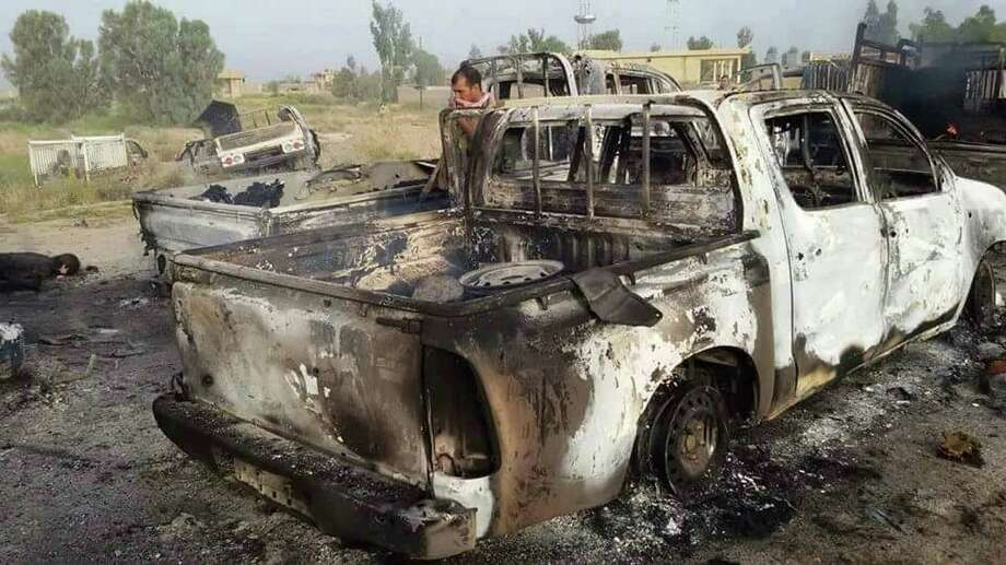 Islamic State fighters fled Fallujah this week, leaving destroyed vehicles like this one abandoned on the outskirts of town. The victorious Iraqi army says it bombed convoys, destroying dozens of vehicles.   Photo: HOGP / Iraq Counterterrorism Service