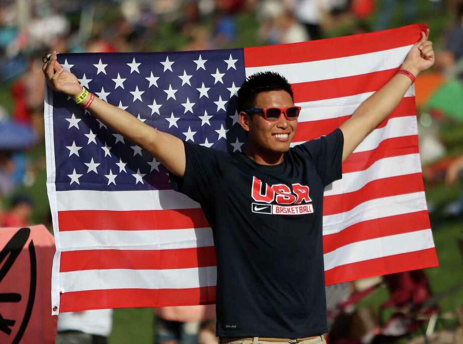 Tommy Huynh, of Houston, celebrates the Fourth of July at Southwest Airlines Freedom Over Texas in Eleanor Tinsley Park on Buffalo Bayou Saturday, July 4, 2015, in Houston. ( Gary Coronado / Houston Chronicle ) Photo: Gary Coronado, Staff / © 2015 Houston Chronicle