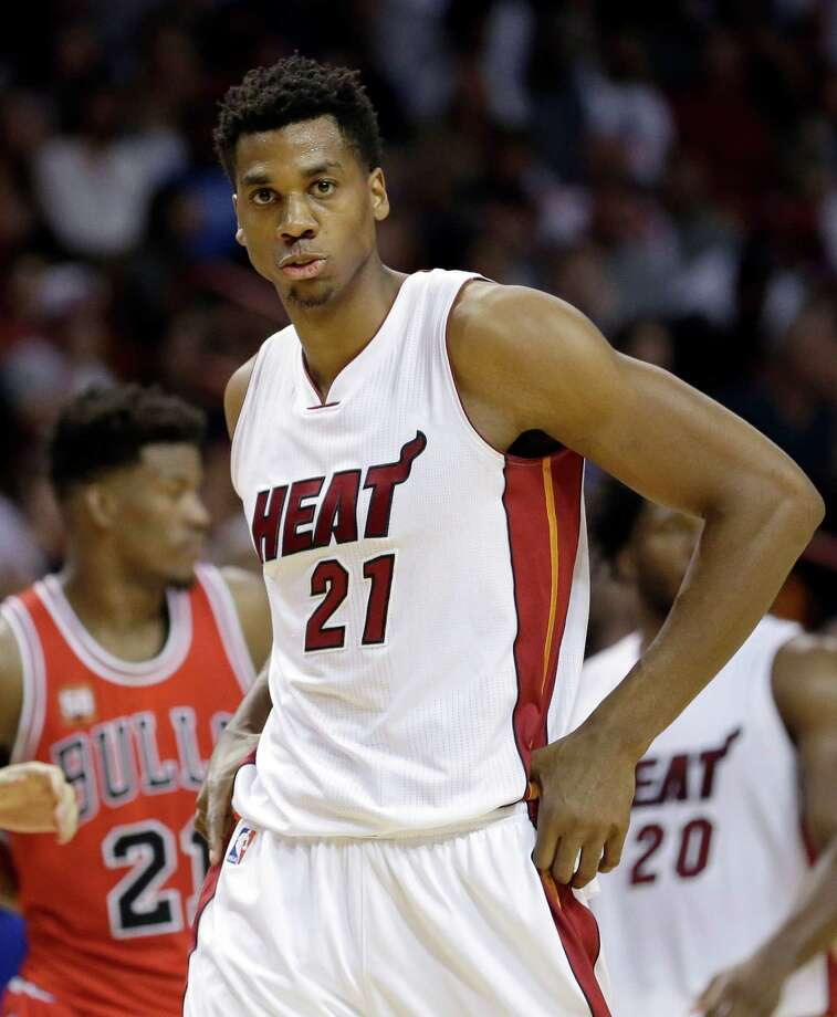 FILE - In this April 7, 2016 photo shows Miami Heat center Hassan Whiteside  walks on the court during the second half of an NBA basketball game against the Chicago Bulls in Miami. Whiteside and others are ready to decide their NBA futures, with free agency beginning Friday, July 1, 2016. Teams have more cap room than ever, meaning this could be one of the more highly anticipated periods in league history. (AP Photo/Alan Diaz, File) ORG XMIT: NY175 Photo: Alan Diaz / AP