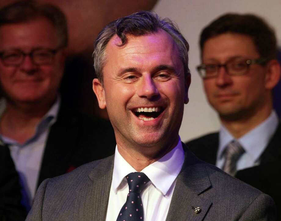 FILE - In this May 22, 2016 file picture Norbert Hofer candidate for Austria's Presidency for Austria's Freedom Party, FPOE, smiles in Vienna, Austria.  Austria's highest court ruled Friday July 1, 2016  that presidential elections narrowly lost by  right-wing candidate  Hofer must be repeated after his party claimed gross irregularities in the absentee vote count. Norbert Hofer was leading after polls closed. But final results after a count of absentee ballots put former Green party politician Alexander Van der Bellen ahead by only a little more than 30,000 votes.  (AP Photo/Ronald Zak,File) Photo: Ronald Zak, STR / Copyright 2016 The Associated Press. All rights reserved. This material may not be published, broadcast, rewritten or redistribu