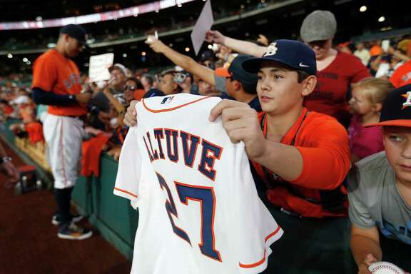 Considering the banner month Jose Altuve just had, it's safe to assume his No. 27 jersey may become a hot item for autograph-seeking fans like these Friday.