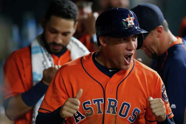 Houston Astros right fielder George Springer (4) celebrates his run scored on a single by Carlos Correa during the fourth inning of an MLB baseball game at Minute Maid Park, Friday, July 1, 2016, in Houston.