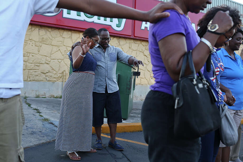 "Pastor Jackie Sattiewhite and Lakesha Sattiewhite, of The Fountain Christian Church, pray at the conclusion of the ""No More Violence Peace March and Rally"" on the East Side in San Antonio on Friday, July 1, 2016. Photo: Lisa Krantz, SAN ANTONIO EXPRESS-NEWS / SAN ANTONIO EXPRESS-NEWS"
