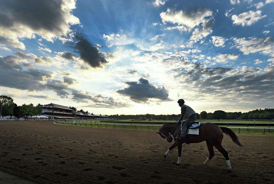 A horse from trainer H. James Bond is worked on the main track at Saratoga Race Course Friday morning, Friday July 1, 2016, in Saratoga Springs, N.Y. The main track was opened for training for the first time this season. Saratoga's racing season starts on July 22.   (Skip Dickstein/Times Union) Photo: SKIP DICKSTEIN / 20037181A
