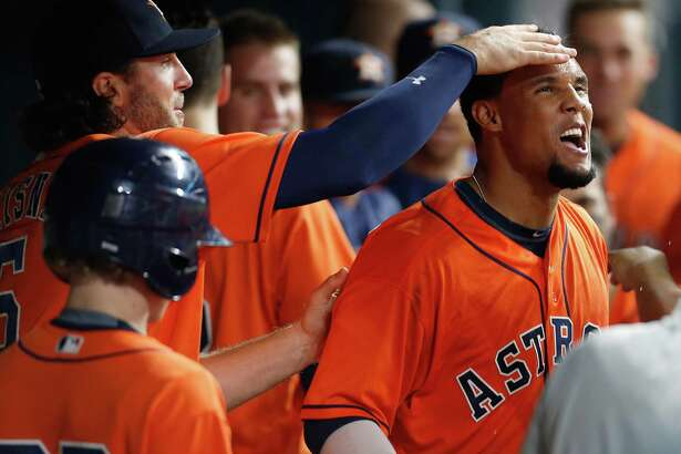 Houston Astros center fielder Carlos Gomez (30) celebrates with teammates in the dugout after his two-run home run during the seventh inning of an MLB baseball game at Minute Maid Park, Friday, July 1, 2016, in Houston.