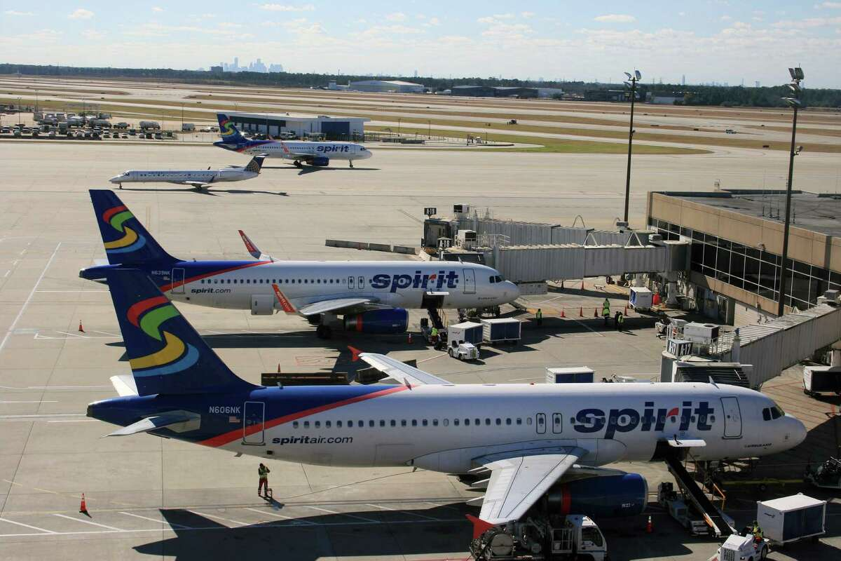 Spirit Airlines planes are seen at Bush Intercontinental Airport. The low-cost airline is adding to more routes at IAH.