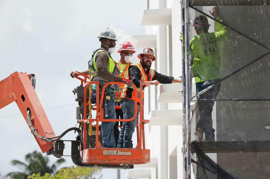 A construction crew works on a building in Miami Beach, Fla.  U.S. construction spending fell in May. Photo: Wilfredo Lee, STF / Copyright 2016 The Associated Press. All rights reserved. This material may not be published, broadcast, rewritten or redistribu