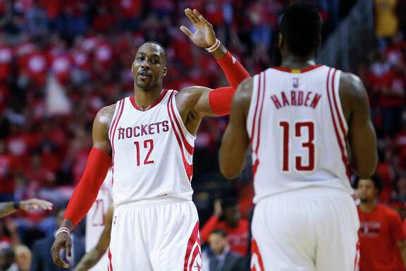Dwight Howard, left, and James Harden no longer have to try to work things out as Rockets teammates.