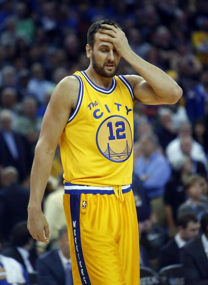 Golden State Warriors' Andrew Bogut reacts to getting hit in the head in 4th quarter against Toronto Raptors during Warriors' 115-110 win in NBA game at Oracle Arena in Oakland, Calif., on Tuesday, November 17, 2015. Photo: Scott Strazzante, The Chronicle