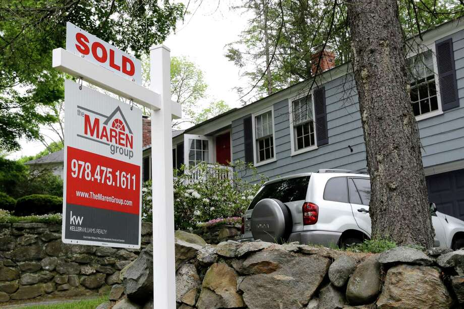 """FILE - This Tuesday, May 24, 2016, file photo shows a """"Sold"""" sign in front of a house in Andover, Mass. On Wednesday, June 29, the National Association of Realtors releases its May report on pending home sales, which are seen as a barometer of future purchases. (AP Photo/Elise Amendola, File) Photo: Elise Amendola, STF / Copyright 2016 The Associated Press. All rights reserved. This material may not be published, broadcast, rewritten or redistribu"""