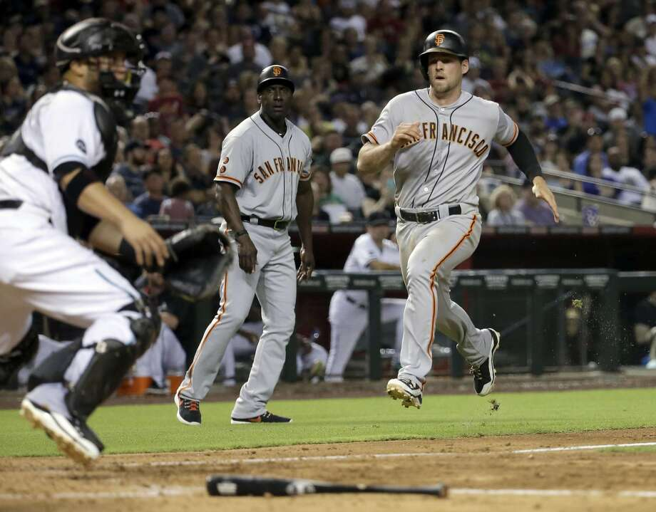 Conor Gillaspie, who singled, doubled and tripled, scores on Trevor Brown's double in the sixth inning. Photo: Matt York, Associated Press