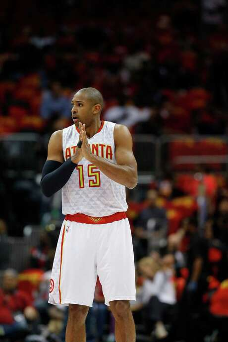 Hawks center Al Horford is also the center of the Rockets' attention. Photo: John Bazemore, STF / AP