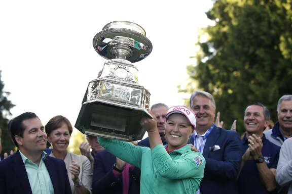 Brooke Henderson, of Canada, lifts the championship trophy after winning the Women�s PGA Championship golf tournament at Sahalee Country Club Sunday, June 12, 2016, in Sammamish, Wash. (AP Photo/Elaine Thompson)