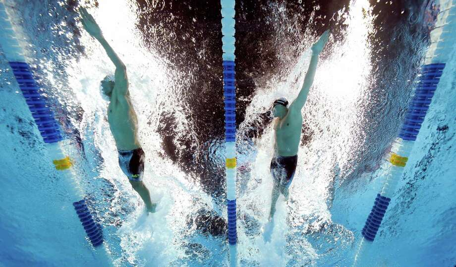 OMAHA, NE - JULY 01:  Michael Phelps (L) and Ryan Lochte (R) of the United States compete in a heat for the Men's 200 Meter Individual Medley during Day Six of the 2016 U.S. Olympic Team Swimming Trials at CenturyLink Center on July 1, 2016 in Omaha, Nebraska.  (Photo by Tom Pennington/Getty Images) ORG XMIT: 606595429 Photo: Tom Pennington / 2016 Getty Images