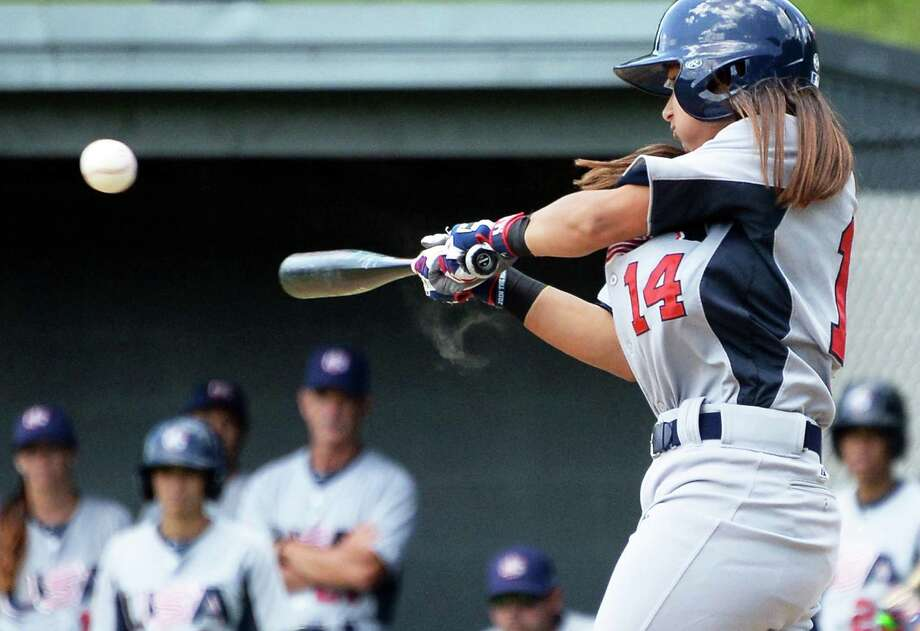 USA Baseball WomenOs National Team's #14 Kelsie Whitmore makes contact during the opening game of the Cooperstown WomenOs Baseball Classic against JapanOs Madonna Stars Friday July 10, 2015 at SUNY in Cobleskill, NY.   (John Carl D'Annibale / Times Union) Photo: John Carl D'Annibale / 00032552A