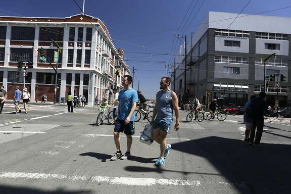 People enjoy the sunshine during Sunday Streets on Third Street in the Dogpatch Neighborhood of San Francisco on Sunday, April 12, 2015.