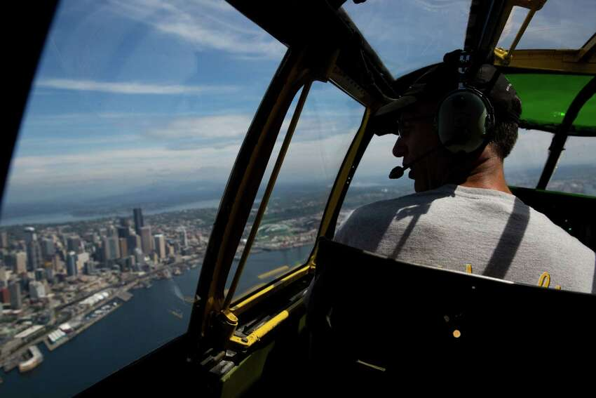 Pilot Wilbur Dismukes looks at Seattle from the cockpit of a B-25 Mitchell bomber during a press flight from the Museum of Flight with the Wings of Freedom Tour, Friday, July 1, 2016.