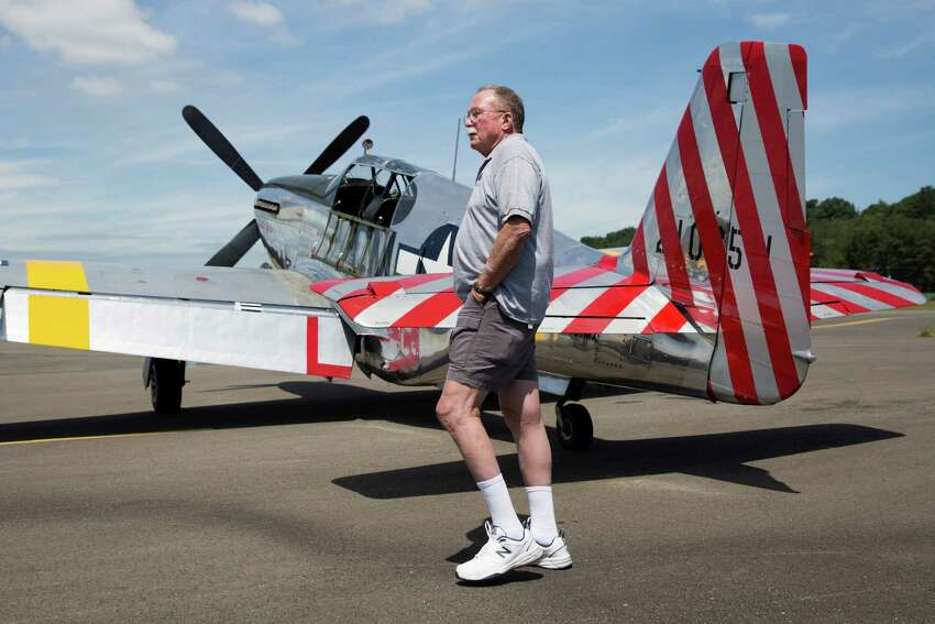Ed Rusch walks past a Mustang P51 as the Wings of Freedom Tour arrives at the tarmac outside the Museum of Flight, Friday, July 1, 2016. The planes are offering paid rides to the public throughout the holiday weekend.