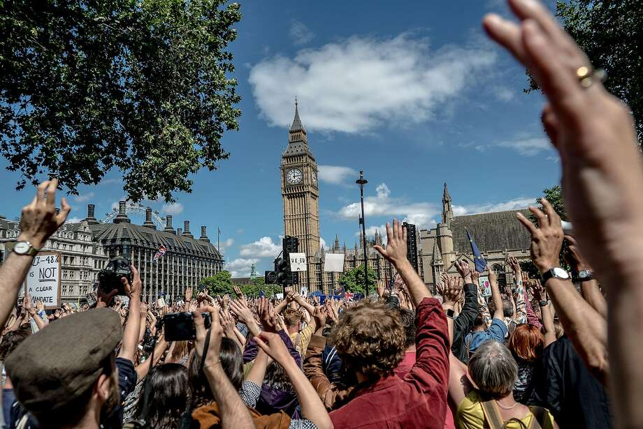 Opponents of Britain's vote to leave the European Union gather near Big Ben in London. The June 23 referendum showed 52 percent supporting the split. Photo: ANDREW TESTA, NYT