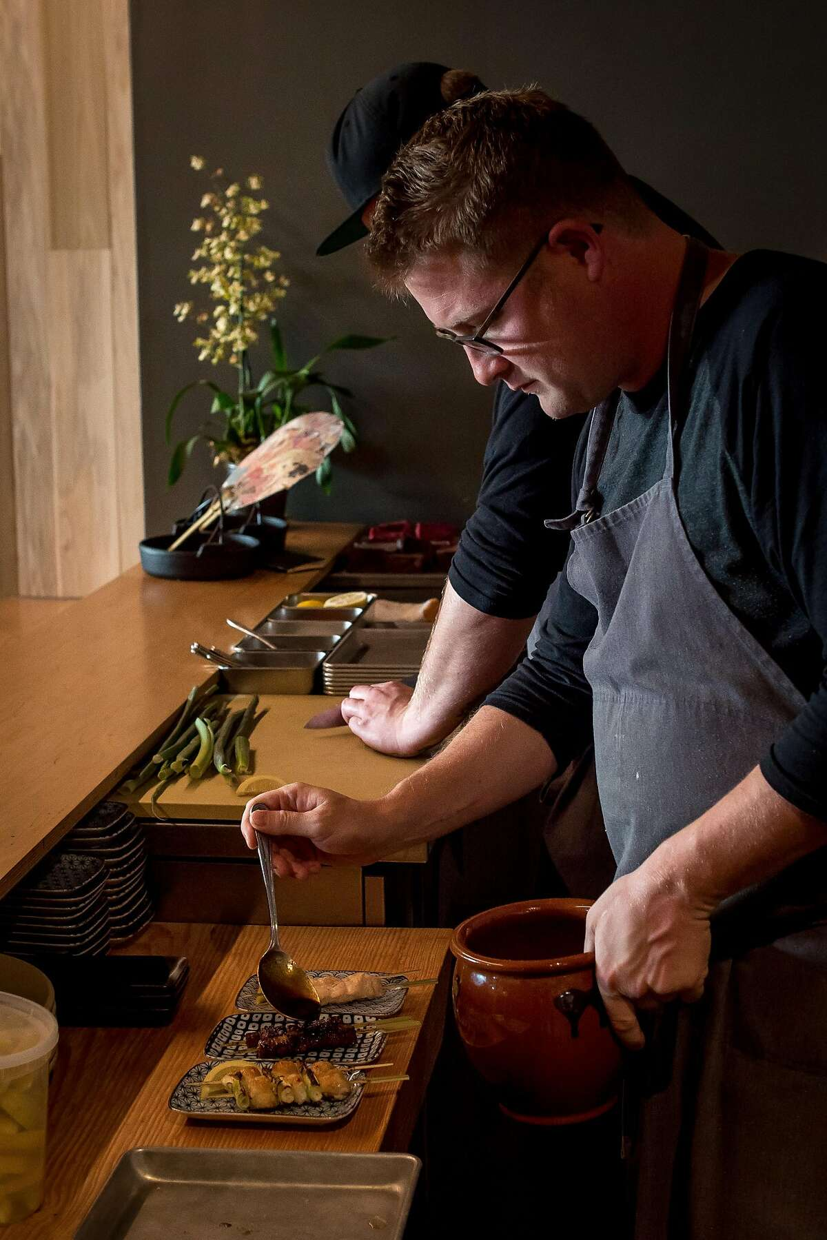 Chef Curtis Di Fede plates the Yakitori at Miminashi in Napa, Calif. on June 30th, 2016.