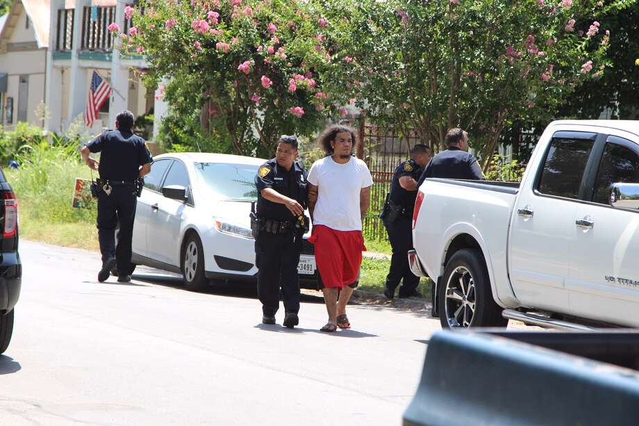 San Antonio Police say a standoff on the city's South Side ended peacefully Saturday afternoon, July 2, 2016, after the suspect surrendered. The suspect is accused of pistol whipping one victim and then barricading himself inside a residence with another person. Police say the suspect fired several shots into the air before they arrived. Photo: By Tyler White, Express-News