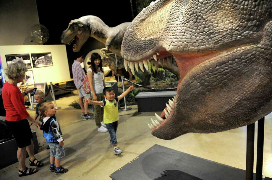 Vistors check out the Return of the Dinosaurs! exhibit at MiScion Saturday July 2, 2016 in Schenectady, N.Y. (Michael P. Farrell/Times Union) Photo: Michael P. Farrell / 20037207A