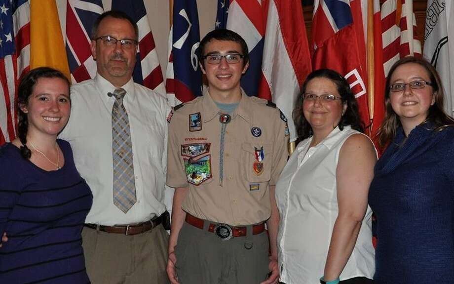 James Bonga, center, of Troop 1 in Ballston Spa, received his Eagle Scout Award at a recent Court of Honor held at the Ballston Spa United Methodist Church.  Pictured with Bonga are sister Katie Bonga, father and assistant scoutmaster Jim Bonga, mother Patrica Bonga,  and sister and Elizabeth Bonga (Submitted photo)   ORG XMIT: rId6pLRA5eJr3DVnPKxS