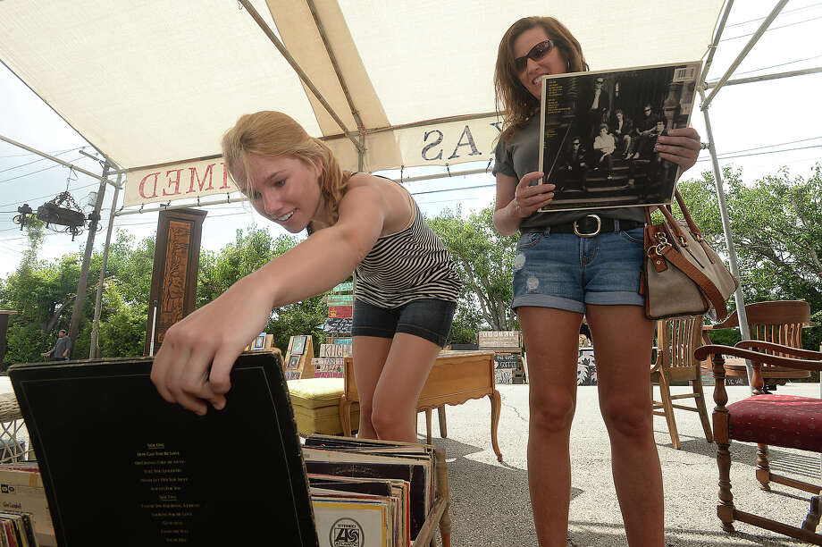 Brooke and mother Jill Castetter sort through crates of old record albums at the monthly Junk Days event held Saturday at BAW Resale & Interiors. Individual vendors also lined Fannin Street, offering their own array of decor and antiques to treasure hunters and deal seekers. Photo taken Saturday, July 2, 2016 Kim Brent/The Enterprise Photo: Kim Brent / Beaumont Enterprise