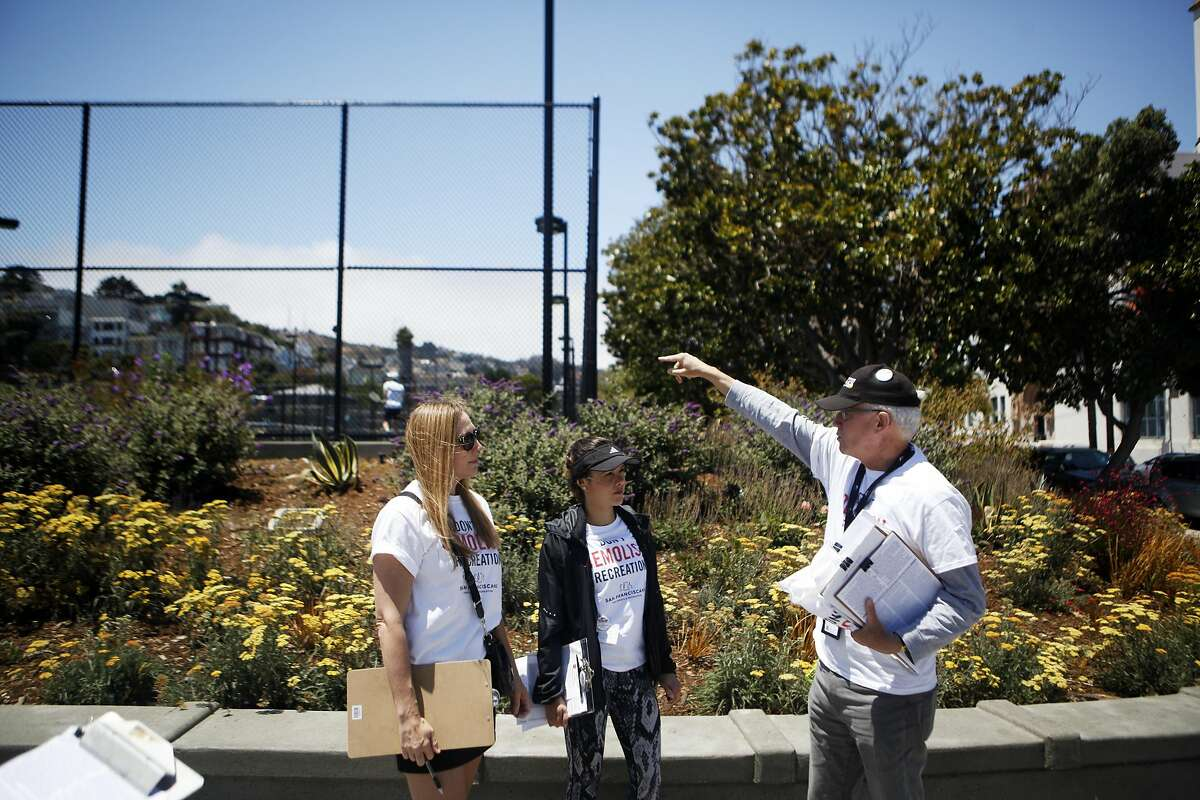 Adele Anfinson, Layla Cavalcante and David Brenlinger begin to plan how to get signatures on Saturday, July 2, 2016 at Mission Dolores Park in San Francisco, California. This ballot measure is looking to protect the San Francisco Tennis Club, which is slated to be replaced by office buildings, a smaller recreation facility, and some affordable housing.