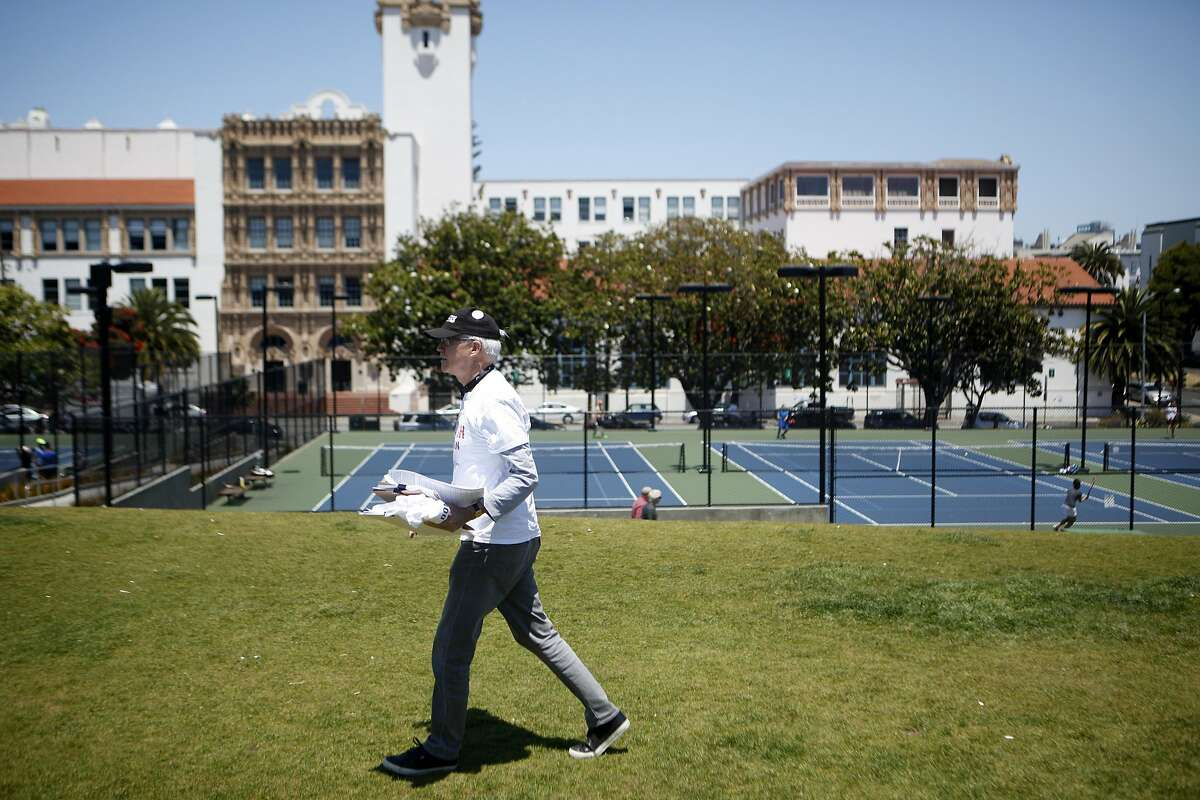 David Brenlinger of San Francisco preps his clipboard before getting signatures on Saturday, July 2, 2016 at Mission Dolores Park in San Francisco, California. This ballot measure is looking to protect the San Francisco Tennis Club, which is slated to be replaced by office buildings, a smaller recreation facility, and some affordable housing.