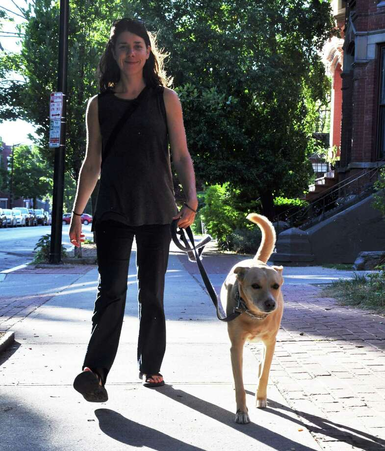 Rachelle McKnight walking her dog, Lady Bird, on Tuesday, June 21, 2016 in Albany, N.Y. (Eliza Mineaux/Special to the Times Union) Photo: Eliza Mineaux / 40037067A