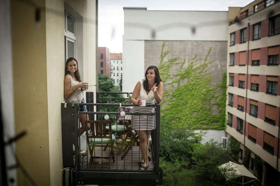 Kim Seele, left, and Carolina Leersch, part of a young generation that sees themselves as European thanks to the ease of cross-border travel and study, on their balcony in Berlin, July 1, 2016. The OBrexitO vote has fundamentally shaken young adults across the continent, many of whom have used the European UnionOs Erasmus program of student exchanges. (Gordon Welters/The New York Times) ORG XMIT: XNYT36 Photo: GORDON WELTERS / NYTNS