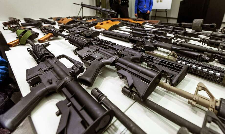 FILE - In this Dec. 27, 2012, file photo, a variety of military-style semi-automatic rifles obtained during a buy back program are displayed at Los Angeles police headquarters. Gov. Jerry Brown signed six stringent gun-control measures Friday, July 1, 2016, that will require people to turn in high-capacity magazines and require background checks for ammunition sales, as California Democrats seek to strengthen gun laws that are already among the strictest in the nation. (AP Photo/Damian Dovarganes, File) Photo: Damian Dovarganes, STF / Copyright 2016 The Associated Press. All rights reserved. This material may not be published, broadcast, rewritten or redistribu