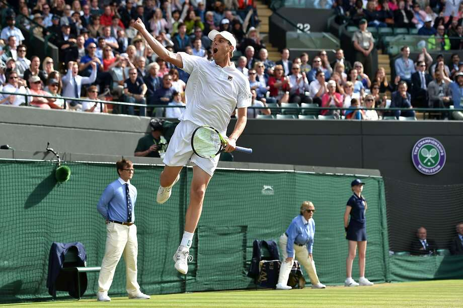 Sam Querrey jumps for joy after beating Novak Djokovic during the third round at Wimbledon. Photo: GLYN KIRK, AFP/Getty Images