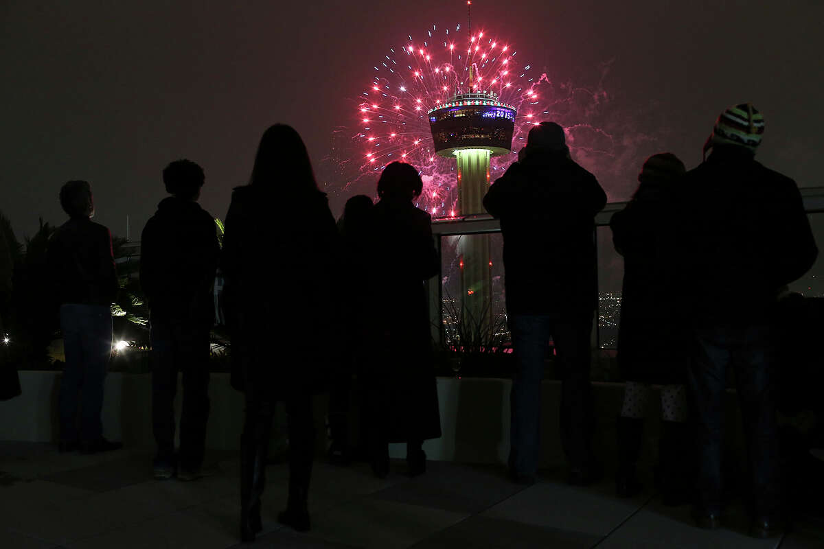Residents and guest of the Alteza Residences watch Celebrate San Antonio New Year fireworks display by the Tower of the Americas, Thursday, Jan. 1, 2015. A crowd of 70,000 was expected to attend the event that is considered the largest free New Year's celebration in Texas.