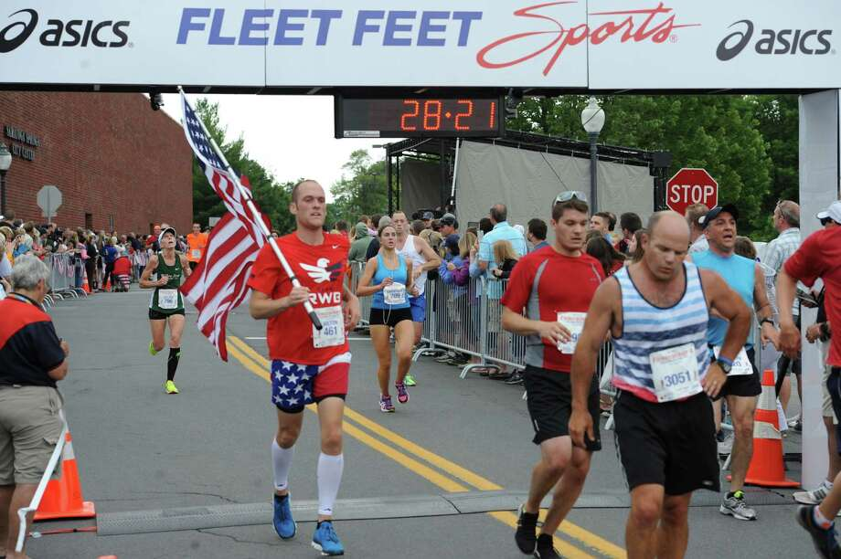 Honoring Independence Day is always a part of the Firecracker 4 in Saratoga Springs, as this runner showed in 2015. (Dave Harmon / Special to the Times Union)