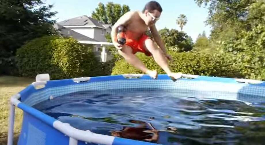 A video of this man is going viral after he filled his pool with Coca-Cola and jumped in. Photo: Courtesy/YouTube