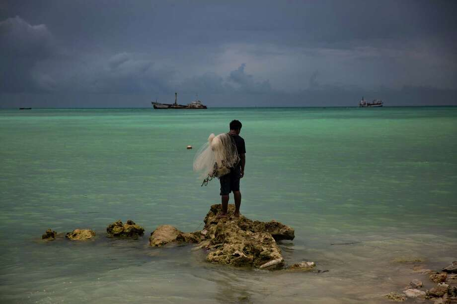 Fisherman Kaitara Kautu's home on the island of South Tarawa in Kiribati was flooded during a king tide last year. Dealing with the results of climate change are a challenge for Kiribati, a resource-poor nation with only one paved road. Photo: JOSH HANER, STF / NYTNS