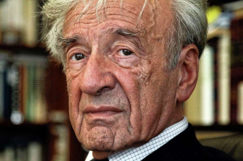 Elie Wiesel received a Congressional Gold Medal from President Ronald Reagan in 1985. Photo: Bebeto Matthews, STF / AP2012