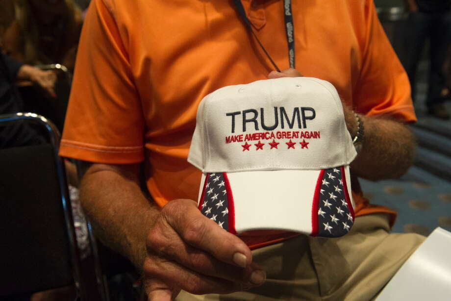 A supporter of Republican Presidential candidate Donald Trump displays his hat at the 2016 Western Conservative Summit on July 1, 2016 in Denver, Colorado.   / AFP PHOTO / Jason ConnollyJASON CONNOLLY/AFP/Getty Images Photo: JASON CONNOLLY / AFP or licensors