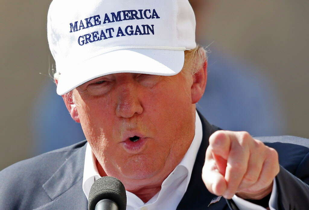 Image result for Trump wearing a Make america great again hat  albany times union
