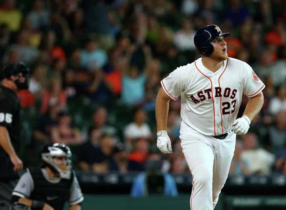Houston Astros first baseman A.J. Reed (23) watches his home run, the first of his major league career, go over the outfield wall during the ninth inning of an MLB game at Minute Maid Park, Saturday, July 2, 2016, in Houston. Photo: Jon Shapley, Houston Chronicle / © 2015  Houston Chronicle