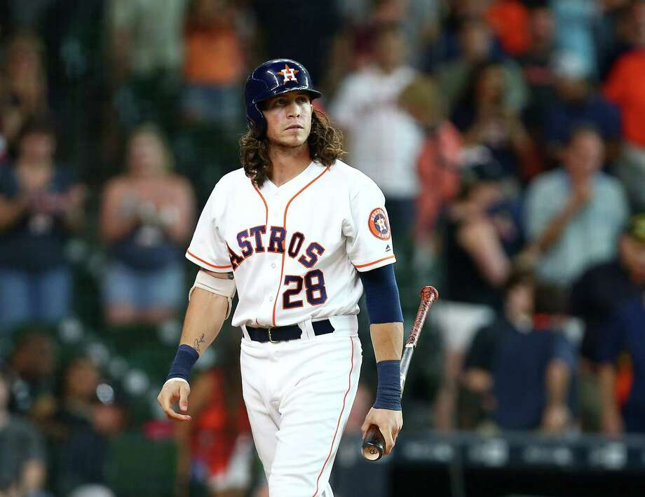 Houston Astros left fielder Colby Rasmus (28) reacts after striking out to end an MLB game against the Chicago White Sox at Minute Maid Park, Saturday, July 2, 2016, in Houston. Photo: Jon Shapley, Houston Chronicle / © 2015  Houston Chronicle