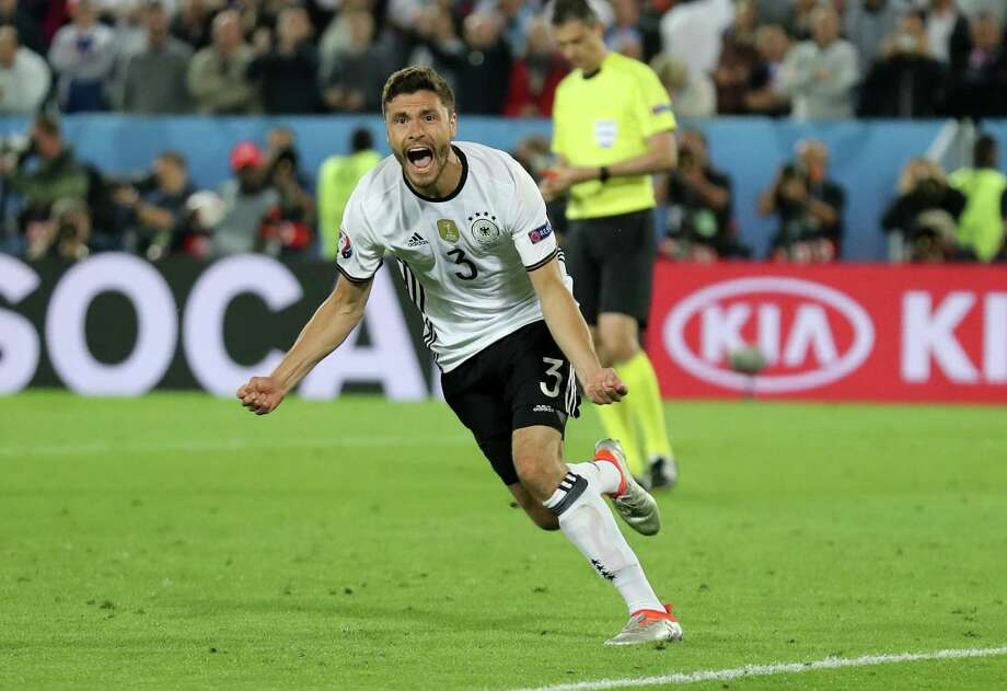 Germany's Jonas Hector celebrates after scoring the winning penalty during the Euro 2016 quarterfinal soccer match between Germany and Italy, at the Nouveau Stade in Bordeaux, France, Saturday, July 2, 2016. Germany beat Italy 6-5 in a penalty shootout. (AP Photo/Antonio Calanni) ORG XMIT: FP153 Photo: Antonio Calanni / AP