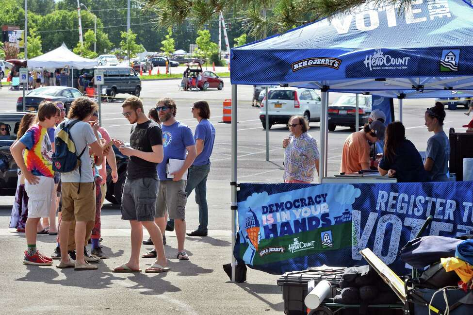 Concert goers register to vote at the Headcount booth and get a free Ben and Jerry's ice cream outside SPAC before the Phish concert Saturday July 2, 2016 in Saratoga Springs, NY. (John Carl D'Annibale / Times Union)