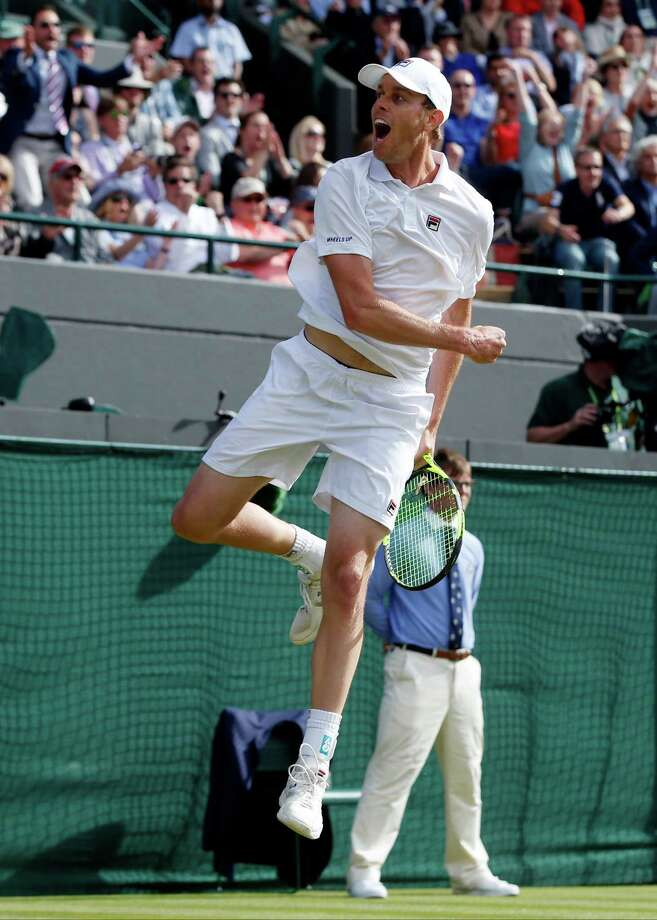American Sam Querrey jumps for joy after his 7-6 (6), 6-1, 3-6, 7-6 (5) third-round upset of top-ranked Novak Djokovic.  Photo: Alastair Grant, STF / Copyright 2016 The Associated Press. All rights reserved. This material may not be published, broadcast, rewritten or redistribu