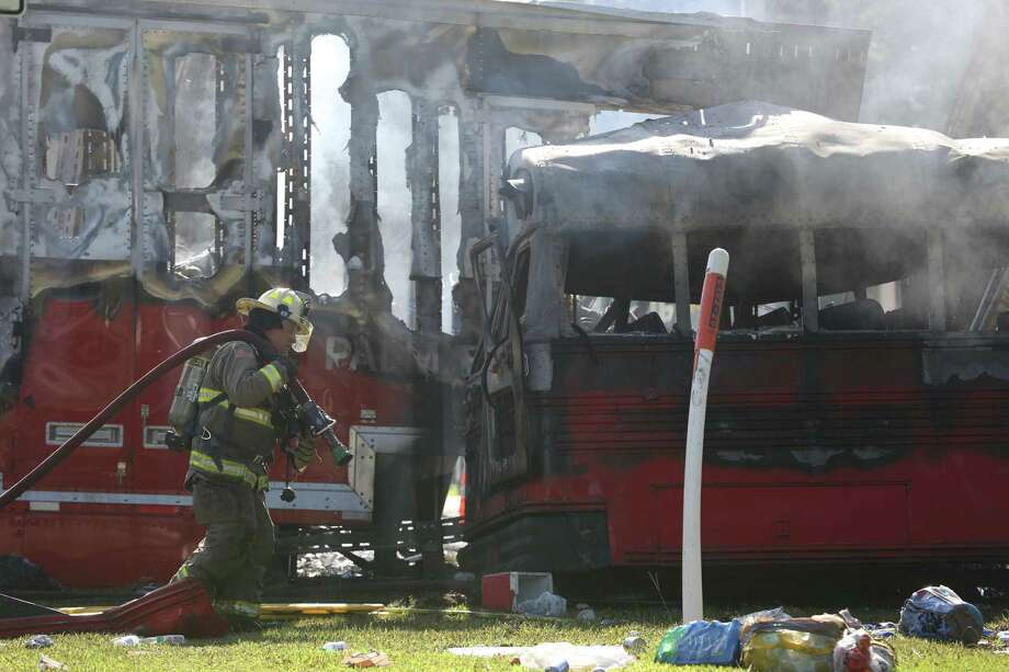 First responders work on the scene of a bus and tractor trailer accident on Saturday in Wakulla, Fla. Photo: Joe Rondone, MBR / Tallahassee Democrat