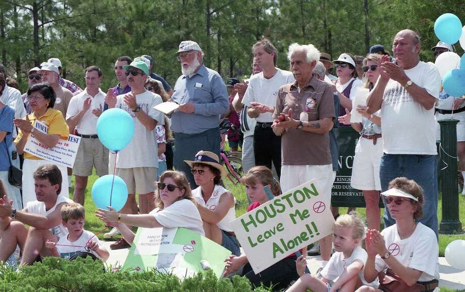 Kingwood residents rallied at a Kingwood park to protest the possible annexation of the community in 1996.  Photo: Betty Tichich, HC Staff / Houston Chronicle